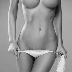 Half-length portrait of sexy beautiful woman with great figure wearing pink swimwear showing