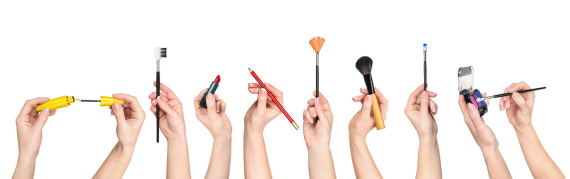 collection of hands holding tools for makeup isolated on white b