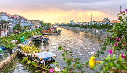 Ho Chi Minh City, Vietnam - February 6th, 2016: Boating along  canal carry flowers with apricot, confetti, almond tree, pulled to sell everyone distillation welcome spring in Ho Chi Minh City, Vietnam