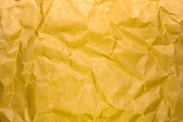 Yellow crumpled recycle paper background and texture