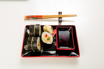 serving of sushi on a plate on a white background