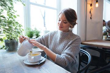 Woman drinking tea in cafe