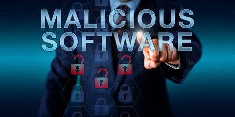 Black Hat Hacker Pressing MALICIOUS SOFTWARE