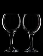 Empty two  wine  glass on black background  in studio  shot