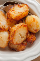 Roast Potatoes cooked in beef fat until crisp and golden a favourite side dish with roast dinners