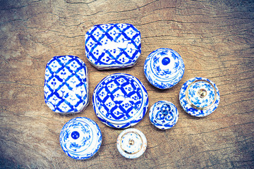 Thai blue porcelain on vintage grunge wooden background