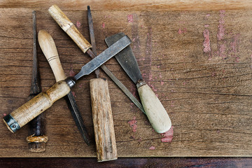 Old vintage rustic carpenter tools on grunge wooden background