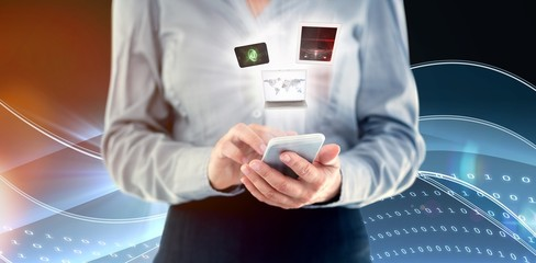 Composite image of businesswoman using smart phone