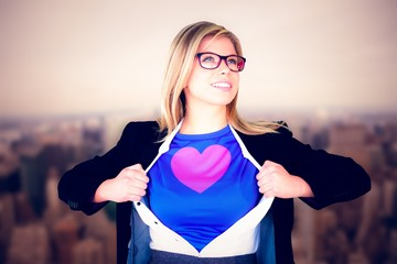 Composite image of businesswoman opening her shirt superhero