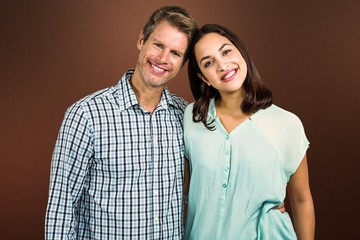 Composite image of portrait of happy couple standing