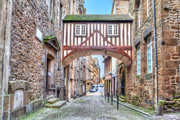 Wooden brigde between two buildigs on narrow street in Saint-Malo, Brittany, France Wall mural