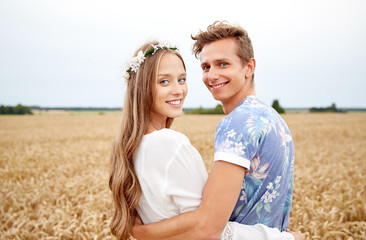 happy smiling young hippie couple outdoors