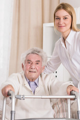 Senior patient with walking frame