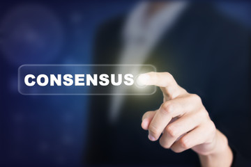 Businessman pressing a CONSENSUS concept button. Can be used in advertising.