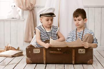 Boys in the image of sailors playing in her room