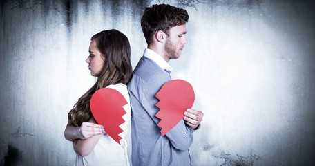 Composite image of side view of couple holding broken heart