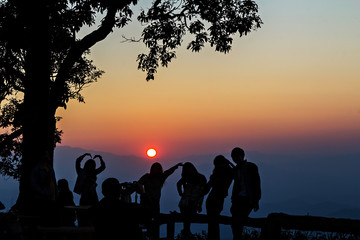 Peoples had happy motion, silhouetted with stunning sunset