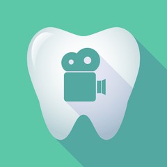 long shadow tooth icon with a film camera