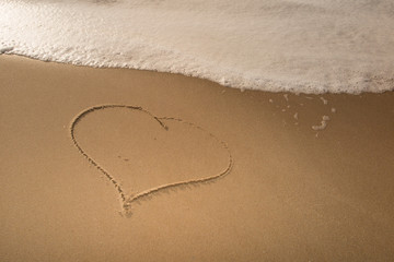 Love and a Heart on the beach.