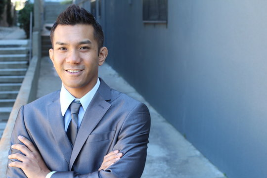 Filipino Businessman Outside Office with copy space on the right