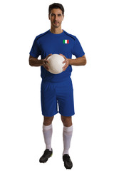 Italian soccer player holding ball on white background