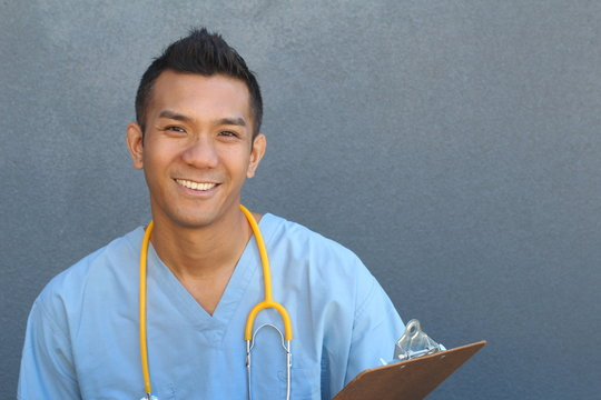 Smiling Asian male nurse with copy space on the right