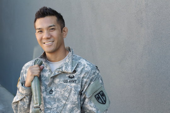 Happy healthy ethnic army soldier with copy space on the right
