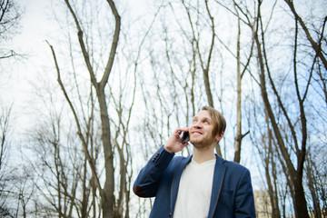 Happy man talking on mobile