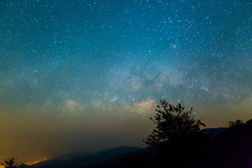 Milky Way rises over the mountain in Thailand.Long exposure photograph.