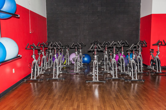 Exercise Bikes Lined Up At Gym