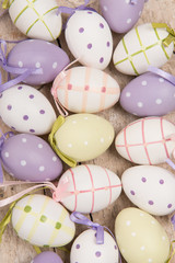 Pastel easter eggs with different colors on a wooden underground