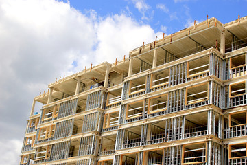 Construction site of residential building on blue sky background