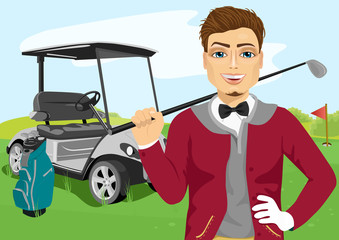 Portrait of handsome male golfer with golf club