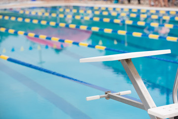 Empty diving block with race lanes in pool