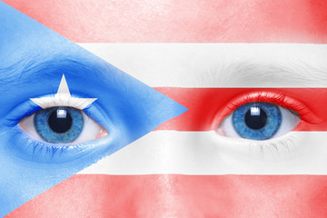 human's face with puerto rico flag