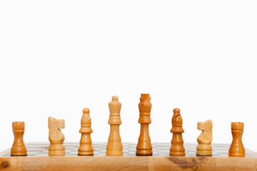 Cream colored wooden chess pieces