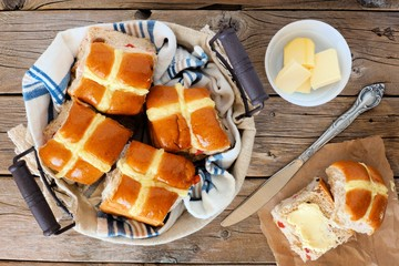 Easter Hot Cross Buns, overhead scene on a rustic wood background