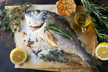 Foto auf Acrylglas Fisch Grilled fish sea bream with aromatic spices, herbs and lemon