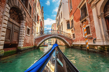 Fotobehang Gondolas View from gondola during the ride through the canals of Venice i