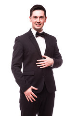 Portrait of happy young man with bowtie looking at camera isolated on white.Showman concept.