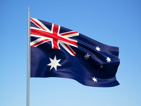 Australia 3d flag floating in the wind with a blue sky background