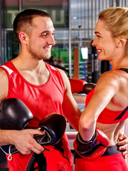 Female boxer with your male coach after workout in gym. Martial arts.
