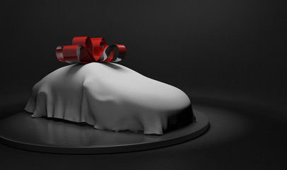 3D car wrapped under a sheet and big red bow