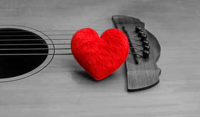 Valentines Day background with red heart on vintage guitar black and white.