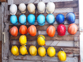 old colrful construction helmets