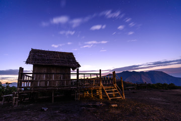 Thai style bamboo cottage with beautiful sky.