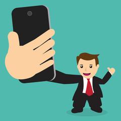 Businessman taking self portrait selfie photo
