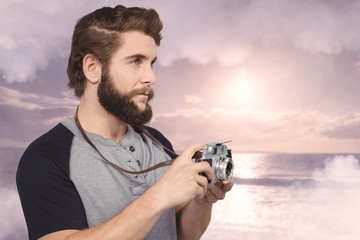 Composite image of hipster using digital camera