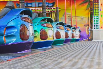 Bumper Cars in a row in amusement park