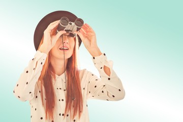 Composite image of smiling hipster woman using binoculars